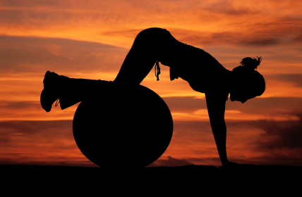 Answer is Fitness - Pilates ball exercise